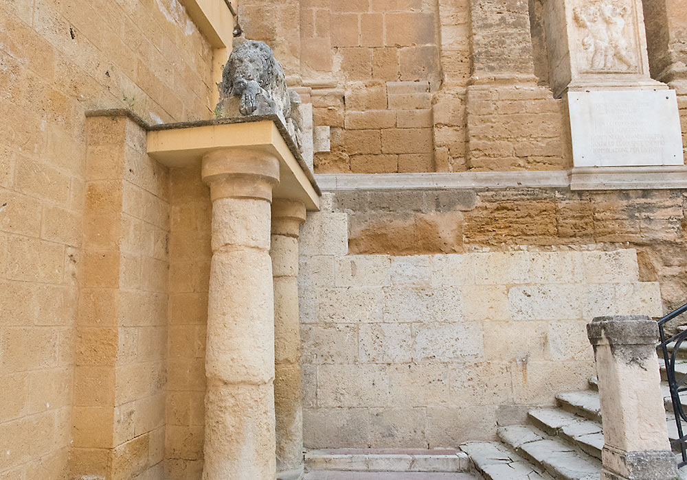 The lion to the left of the church of the Purgatorio sleeps above the locked entrance to a huge labyrinth of underground water-channels and reservoirs, built by the Greek architect Phaiax in the 5th century BC