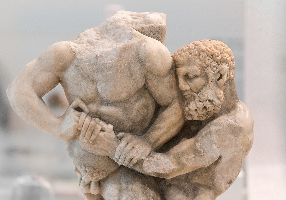 Hercules wrestling with Antaeus. Marble support for table-top. Greek, 200-100 BC