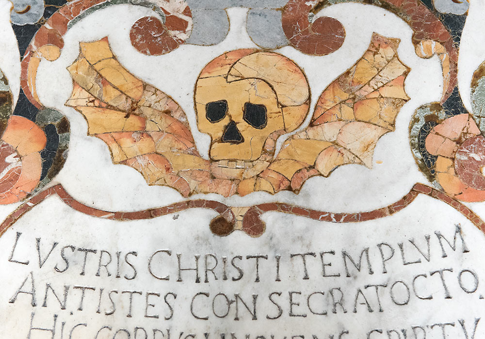 Skull on a marble tomb (anno 1697) in the Church of San Pancrazio, Taormina, Sicily